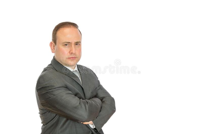 Stern businessman with crossed arms and copy space royalty free stock photography