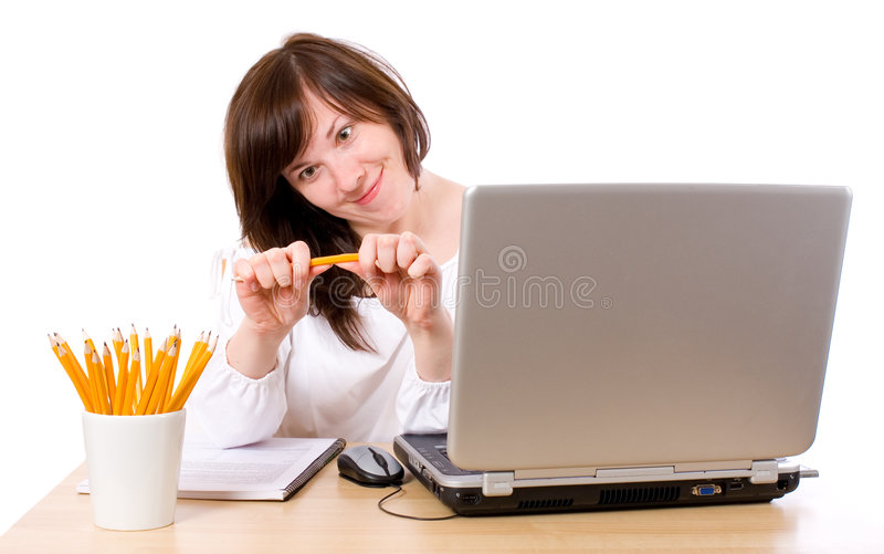 Angry, stresses office worker, breaking pencil royalty free stock photography
