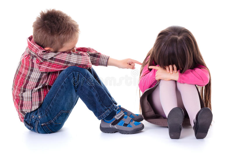 Angry sulking children pointing at each other stock photo