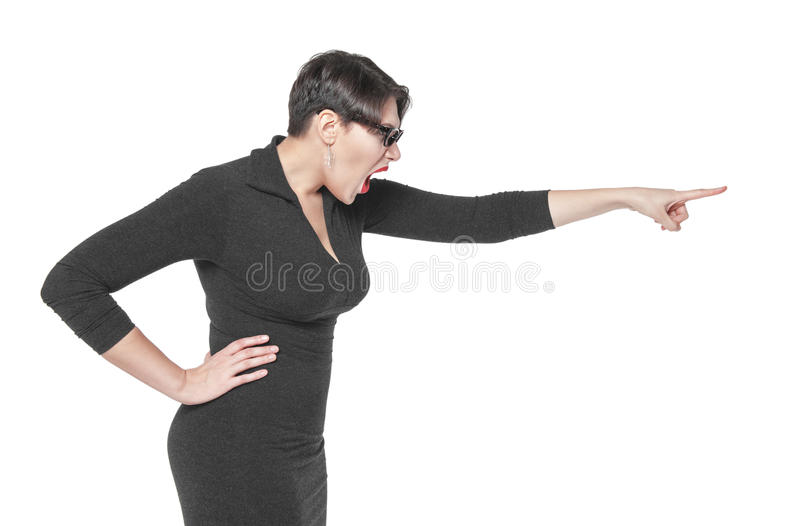 Angry teacher woman pointing out isolated stock photo