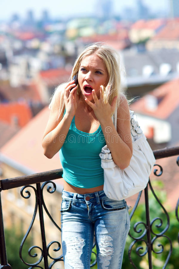 Angry Teen Girl With Mobile Phone Royalty Free Stock Photo