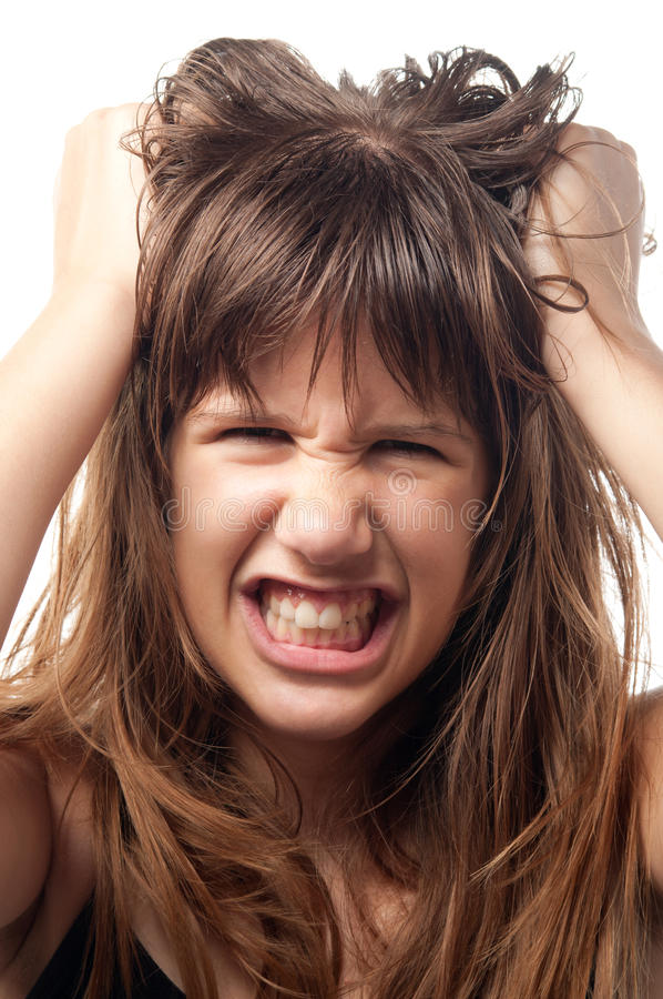 Angry teenage girl. Grinding teeth in frustration royalty free stock photos