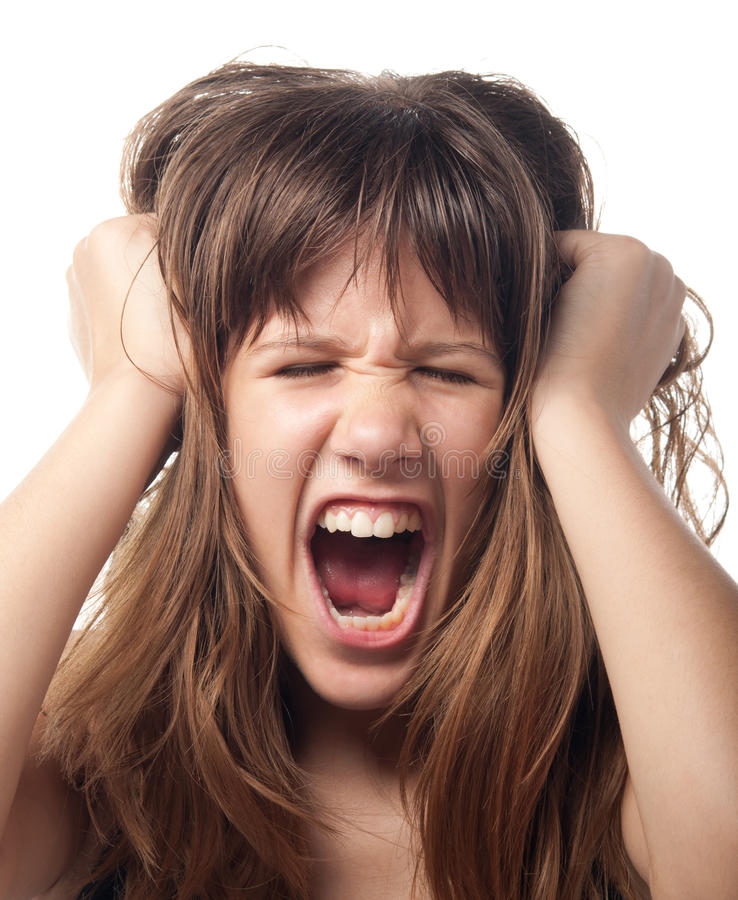 Angry teenage girl. Screaming in frustration royalty free stock photography