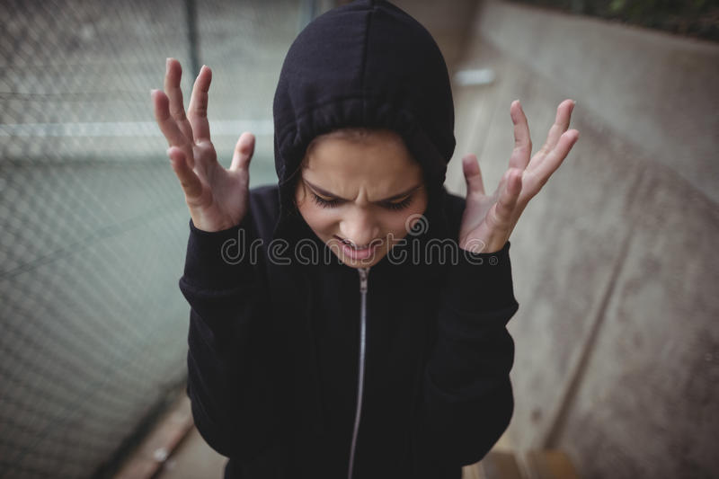 Angry teenage girl standing at school campus stock images