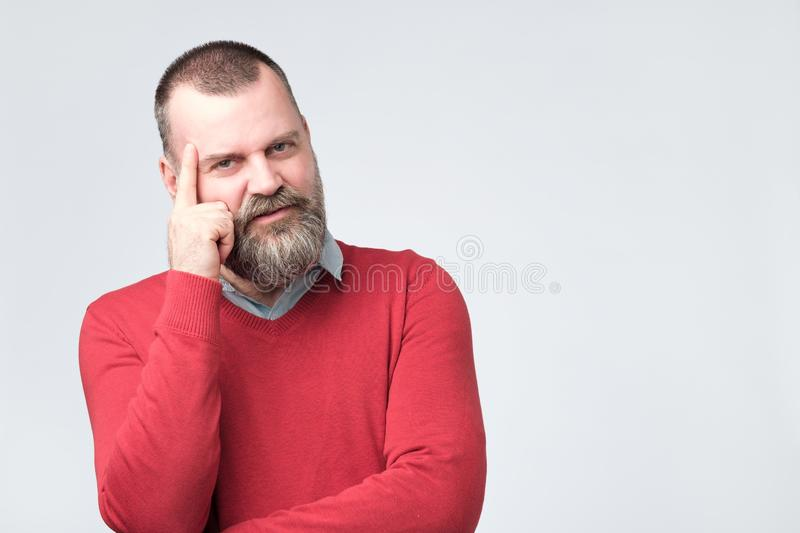 Angry tired european man trying to remember something royalty free stock images