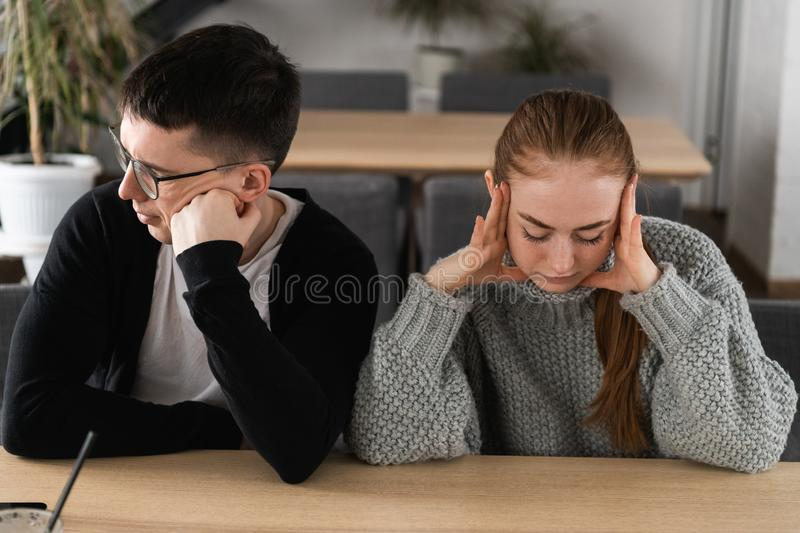 Angry unhappy young couple ignoring not looking at each other after family fight or quarrel, upset thoughtful spouses royalty free stock photography