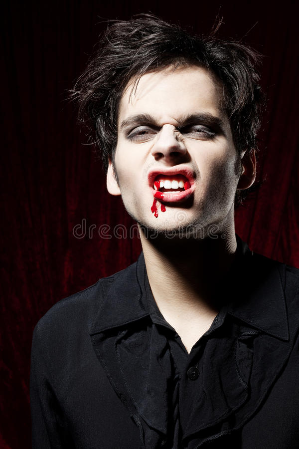 Angry vampire showing his teeth stock photos