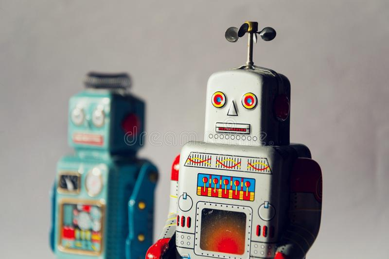 Angry vintage tin toy robots, artificial intelligence, robotic delivery concept stock images