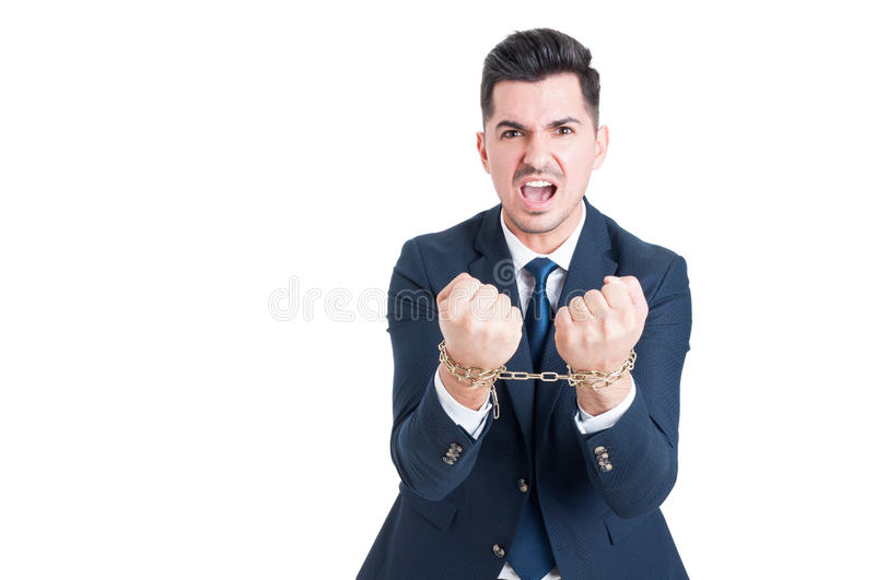 Angry and violent politician with handcuffs being arrested. As bribery concept with copy space isolated on white stock photos
