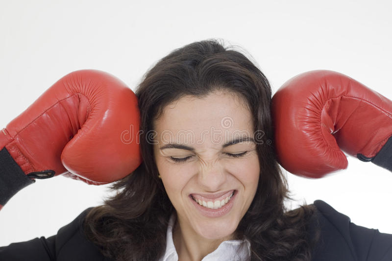 Angry woman. With red boxing gloves royalty free stock image