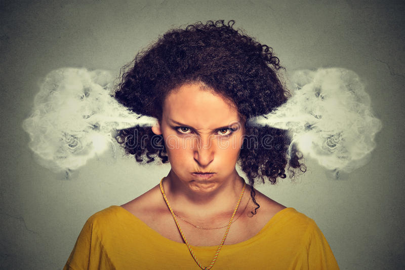 Angry woman, blowing steam coming out of ears. Closeup portrait of angry young woman, blowing steam coming out of ears, about to have nervous atomic breakdown royalty free stock photo