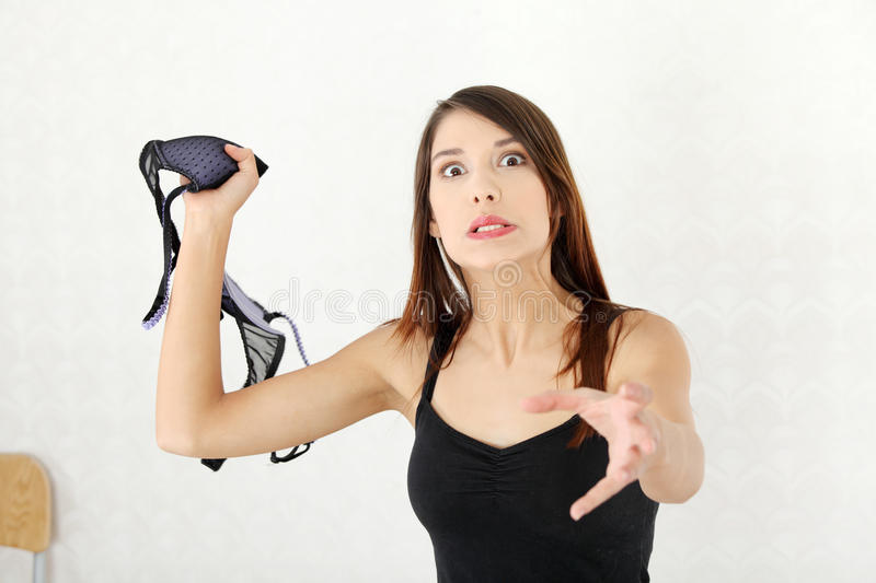Angry woman with bra in hand. royalty free stock images