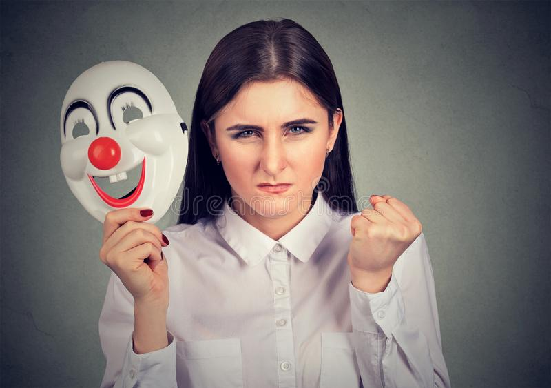 Angry woman with clown mask stock photo