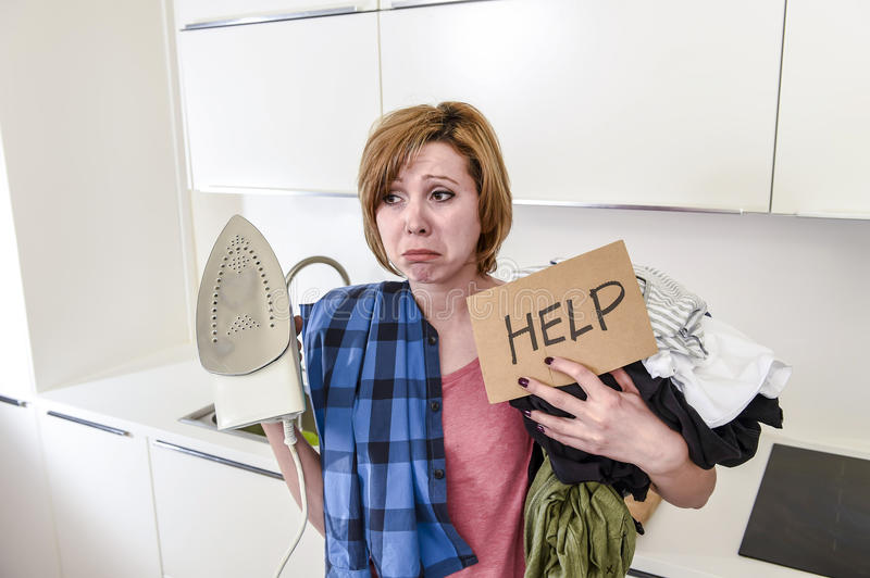 Angry woman or crazy busy housewife ironing shirt lazy at home k royalty free stock images