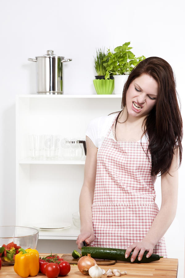 Free Angry Woman Cutting A Cucumber Stock Image - 25381641