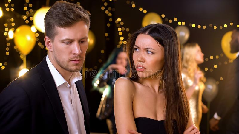 Angry woman feeling offence, suspecting boyfriend in cheating and betrayal. Angry women feeling offence, suspecting boyfriend in cheating and betrayal, stock royalty free stock image