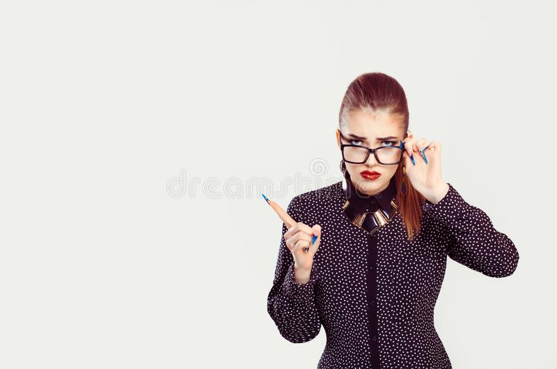 Angry woman looking at you camera showing attention listen to me gesture with hand royalty free stock photos