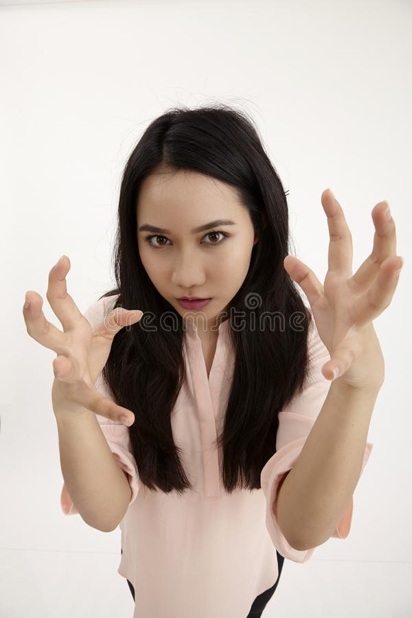 Angry woman. Angry malay woman with both hand open royalty free stock photo
