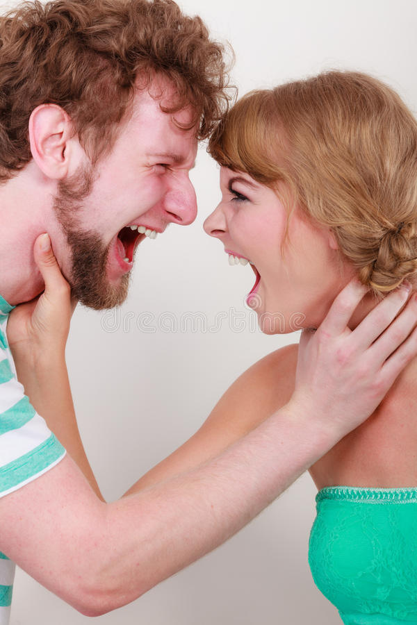 Angry woman and man yelling at each other. Relationship difficulties. Angry women and men yelling at each other. Face to face. Fury couple royalty free stock photo