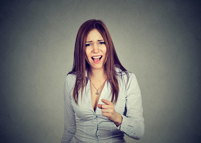 Angry woman pointing at camera. Screaming royalty free stock images