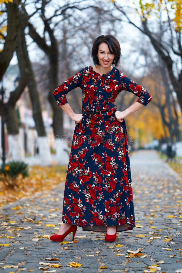Angry woman posing in a city street, autumn season stock image