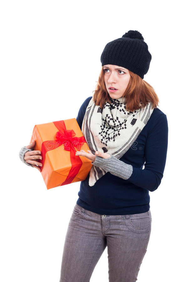 Angry woman with present. Angry winter woman holding present, isolated on white background royalty free stock image