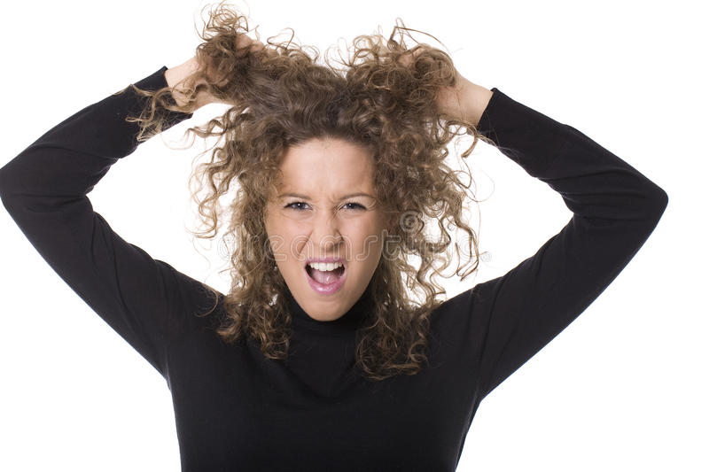 Angry woman pulling hair stock images