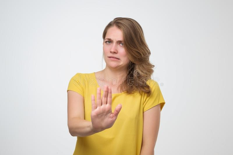 Angry woman refuses offer, rejects something unpleasant royalty free stock image