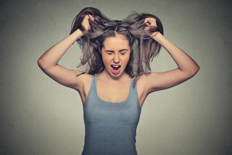 Angry woman screaming acting out stock image