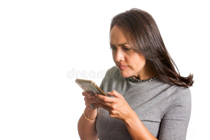 Angry woman texting on her cellphone isolated. On white background royalty free stock photo