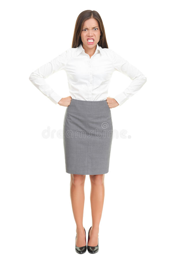 Angry woman : upset business boss on white. Angry upset young business woman standing isolated in full length. Funny concept of mixed race Asian Caucasian female stock photography