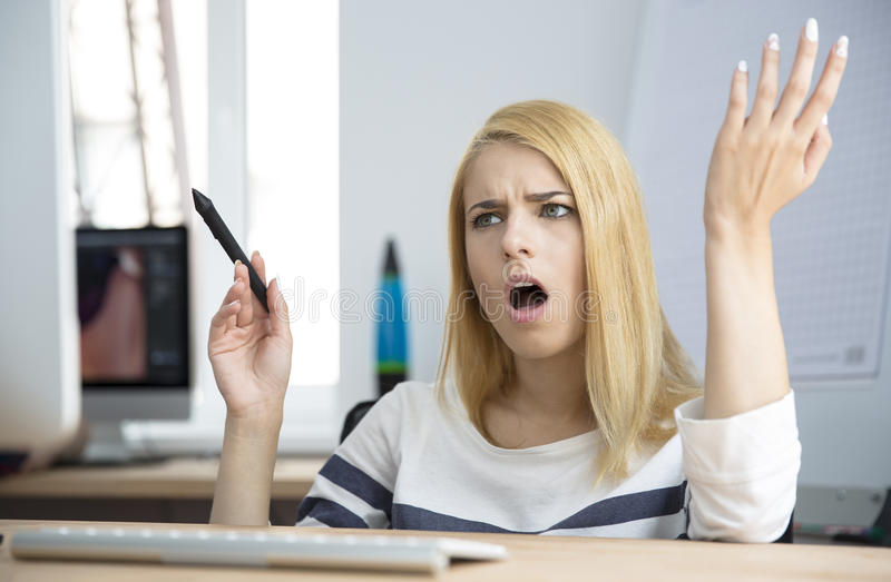 Angry woman working on compute stock photos