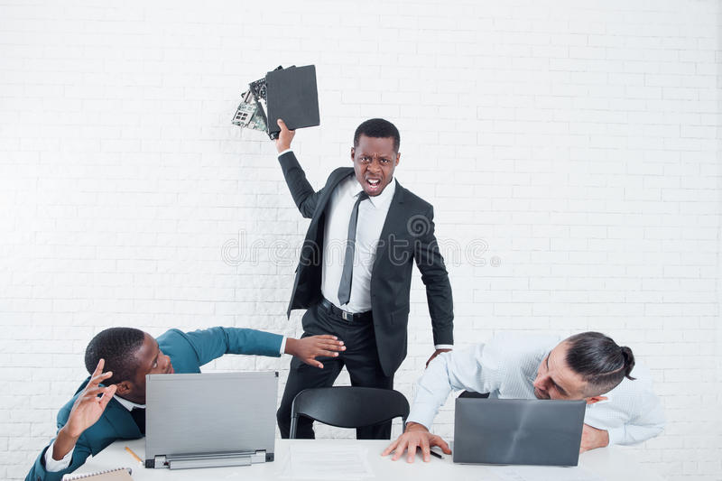 Angry worker leaving company. Firing with scandal. stock images