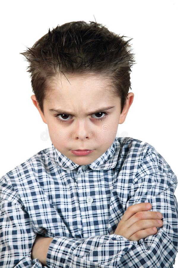Angry young boy in white background stock images