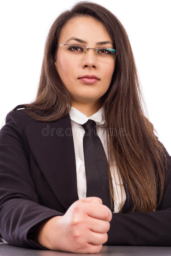 Angry young businesswoman hits desk with her fist stock image