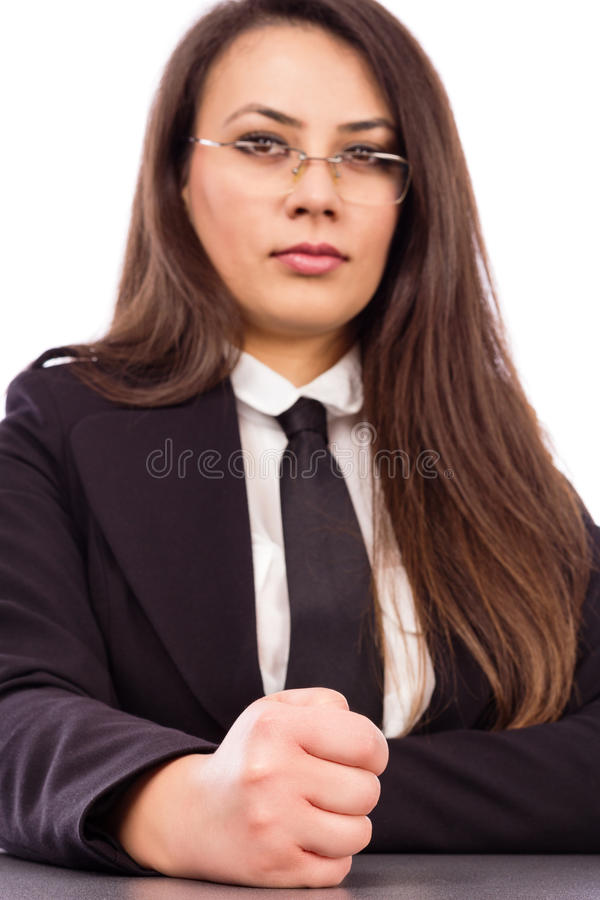 Angry young businesswoman hits desk with her fist royalty free stock photos