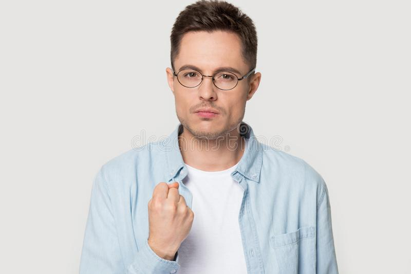 Angry Caucasian man in glasses show fist giving warning stock image