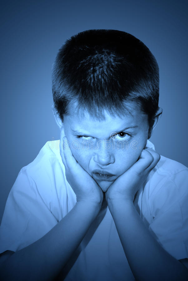 Angry young child stock photos