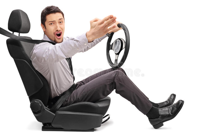 Angry young guy holding a steering wheel. And arguing with someone isolated on white background stock images