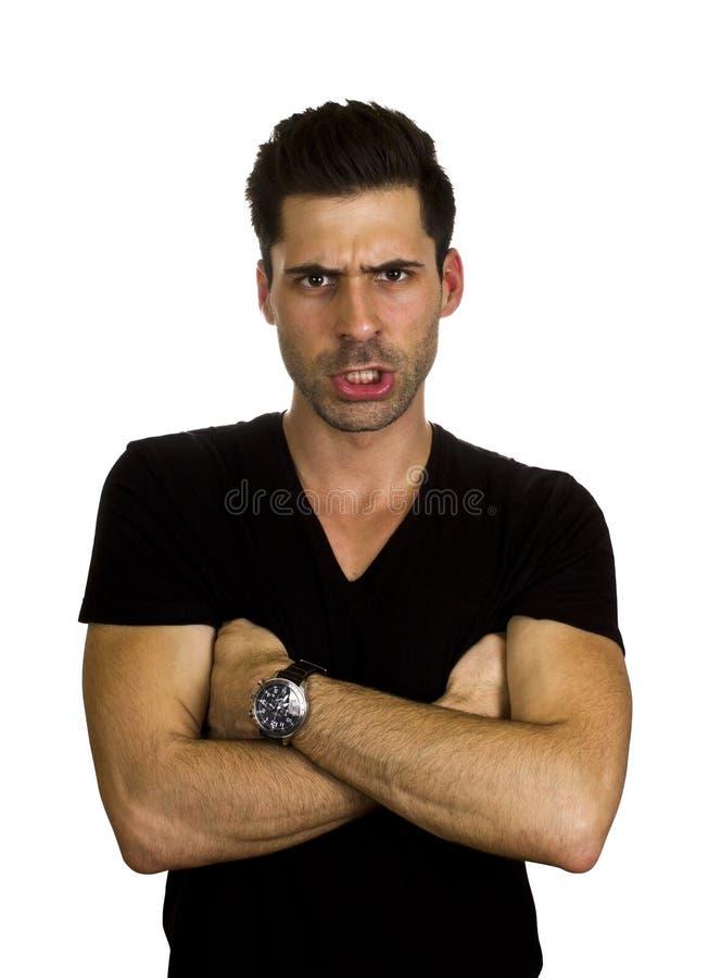 Angry young man stock photos