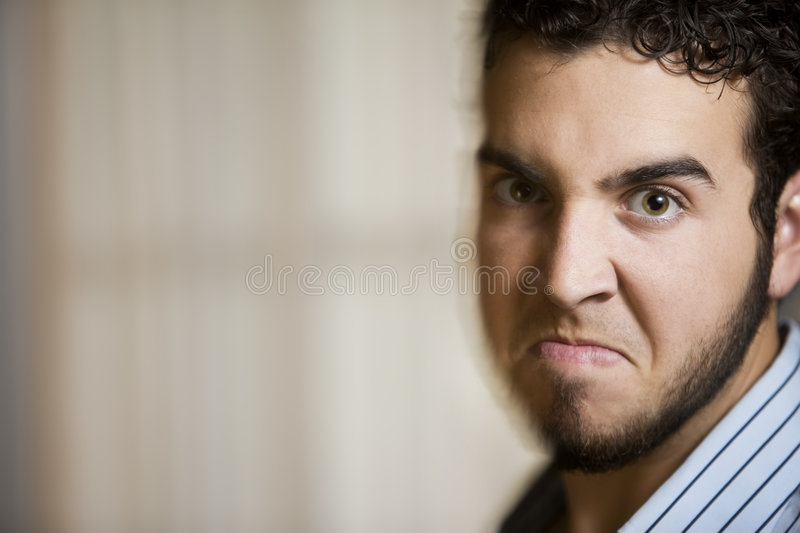 Angry Young Man with Motion Effect. Close Up of Angry Young Man with a Photographic Motion Effect royalty free stock image