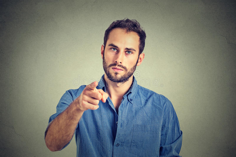 Angry young man pointing finger at you camera gesture royalty free stock photo