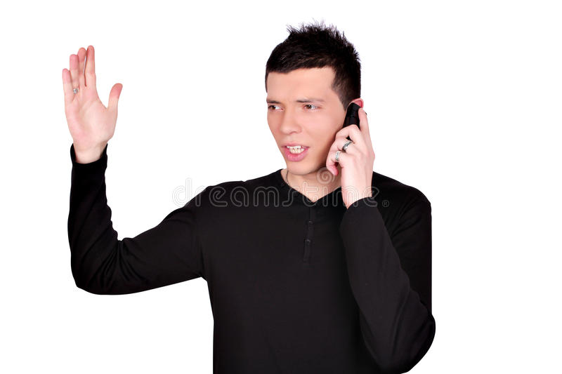 Angry young man talking on phone royalty free stock photo