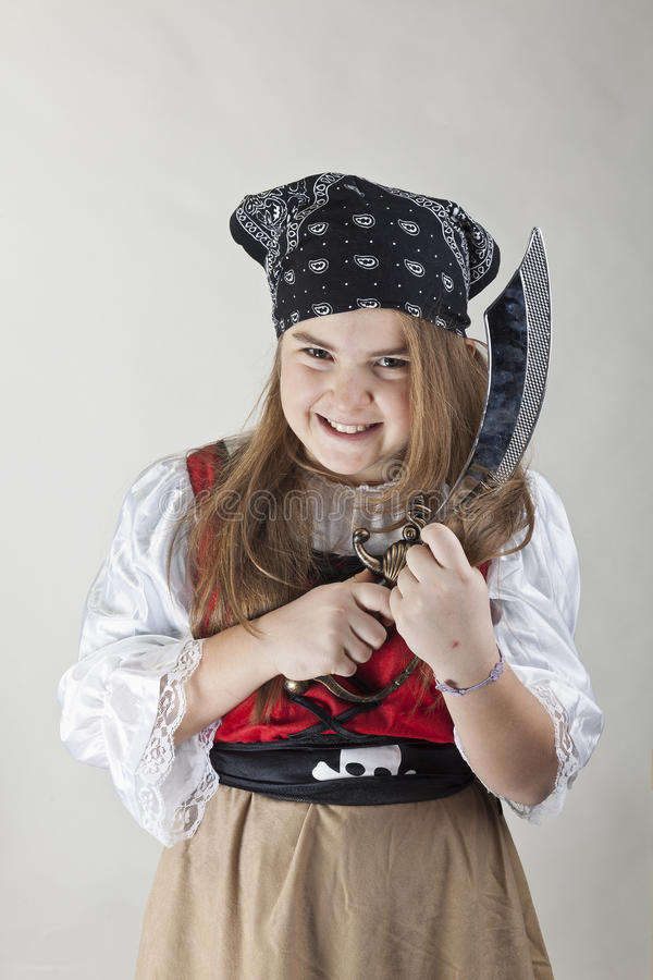 Angry young pirate girl with a sword royalty free stock image