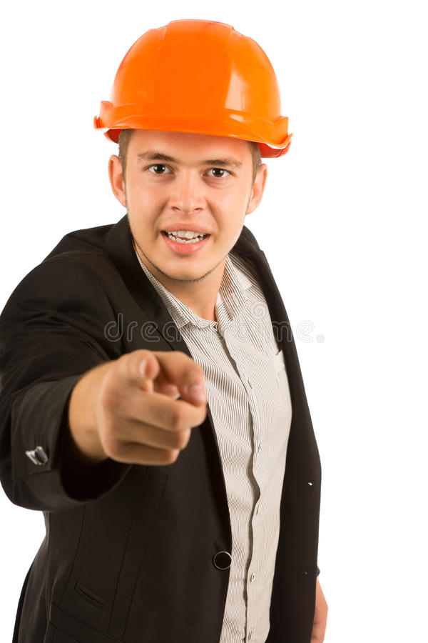 Angry young structural engineer or architect. In a hardhat and suit with a stern expression glaring and pointing his finger at the camera, upper body on white royalty free stock photos