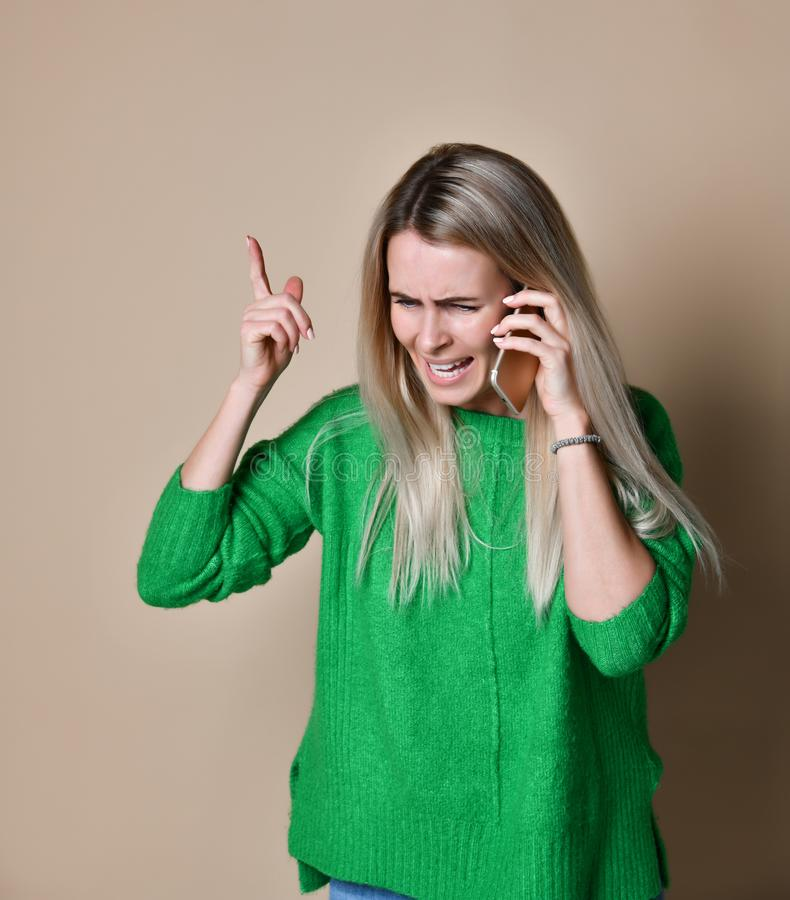 Angry young woman arguing talking on phone stock photos
