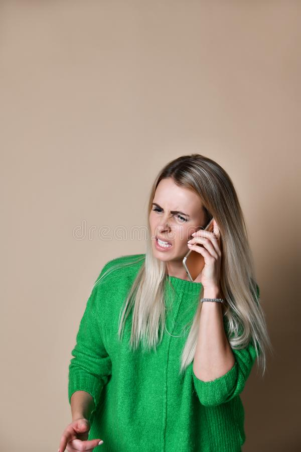Angry young woman arguing talking on phone royalty free stock photos