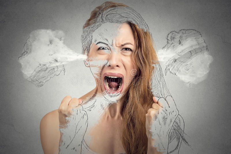Angry young woman blowing steam coming out of ears. Closeup portrait angry young woman blowing steam coming out of ears having nervous breakdown hysterical stock photo