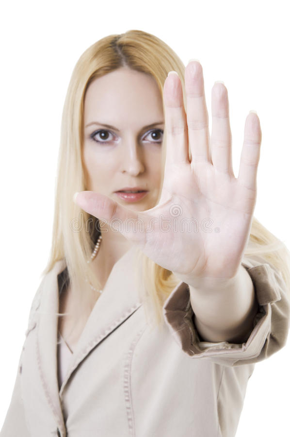 Angry young woman entrepreneur showing stop. Portrait of an angry young woman entrepreneur showing stop sign against white background stock image