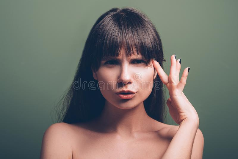 Angry protesting annoyed emotion woman portrait. Angry young woman. Protesting facial expression. Closeup portrait of emotional brunette lady with finger at her royalty free stock images